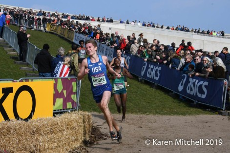 Gabriel Mudel of USA placed 72nd in U20 race. Behind him is the infamous Museum Roof.