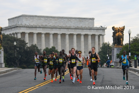 Lead men pass the Lincoln Monument in the first mile of the Credit Union Cherry Blossom 10 Mile Run.