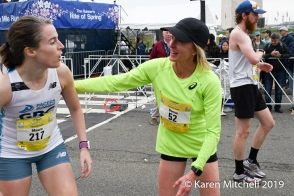Deena Kastor ran 59:15, then stayed around to warmly greet other fast finishers like Maura Carroll of Arlington, VA. Kastor was second master.
