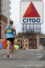 Jared Ward #24 in the final 2K of the Boston Marathon. The iconic Citgo sign and Kenmore Square loom ahead. Ward had a great day with a 2:09:25 and 8th overall.
