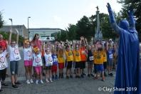 Batman gets the kids ready to run the fun run.