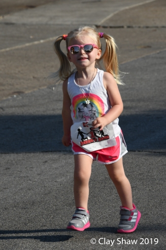 Cute kid in the fun run with her shades.