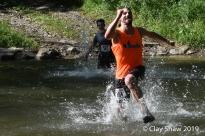 Rich Erdlen of the Flying Feet Racing Team, runs across the water.